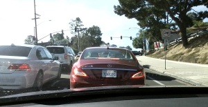 Incompetent Motorist in Del Mar driving this red Mercedes CLS 550, license plate 7GHR391. She tried to crash into my car by attempting a merge without looking. I honked at her and she honked back for daring to honk at her! She turned south on Condesa Dr.